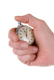 Man's hand holding stopwatch Royalty Free Stock Photography