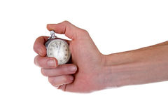 Man's hand holding stopwatch Royalty Free Stock Photos