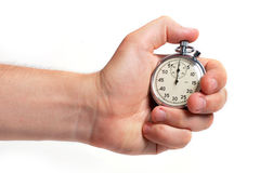 Man's hand holding stopwatch Royalty Free Stock Images