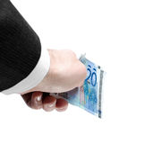 Man's Hand Holding Twenty Euro Notes. Man's hand holding a stack of twenty euro notes isolated on white background Royalty Free Stock Photo
