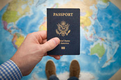 Man's hand holding US passport. Royalty Free Stock Photo