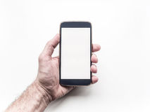 Man's hand holding and using mobile smartphone Royalty Free Stock Photo