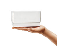 Man`s hand holding white box isolated on white background. Close up. High resolution product Stock Photos
