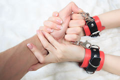 Man's hand holding a woman's hands. The girl in Royalty Free Stock Images