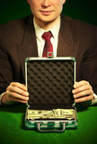 Man S Hand Holds A Suitcase With Dollars Royalty Free Stock Photo