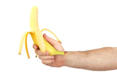 The man's hand holds a banana Stock Images