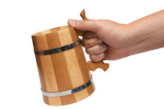 Man's hand holds big wooden beer mug Stock Images
