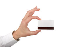 The man's hand holds a card Stock Images
