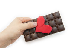 The man's hand holds chocolate Royalty Free Stock Image