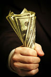 Man's hand holds dollars Royalty Free Stock Images