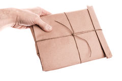 Man's hand holds envelope isolated on white Stock Photo