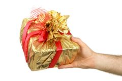 The man's hand holds a gift a box Royalty Free Stock Images
