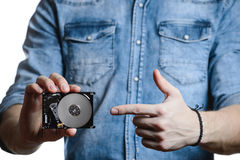 Man`s hand holds a 2.5 inch hard drive. Isolated on white background. Stock Photos