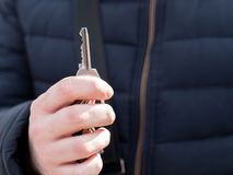 A man`s hand holds the keys. Mortgage concept. royalty free stock image