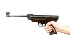 The man's hand holds pneumatic pistol Stock Images