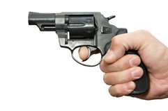 The man's hand holds revolver. Stock Photos