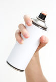 Man`s hand holds a spray of black paint. Isolated on a white bac Stock Image