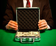 Man's hand holds a suitcase with dollars Stock Photography