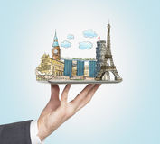 A man's hand holds a tablet with sketches of the most famous places in Italy Royalty Free Stock Photos