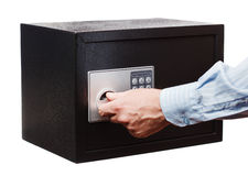 Man`s Hand In A Striped Shirt Open Black Safe Isolated On White. Small Home Or Hotel Safe. Stock Photo