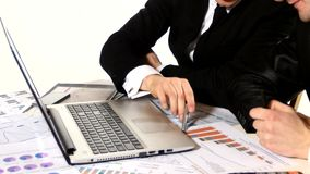 Man's hand on the keyboard: Businessmen discussing. Financial changes, close up stock video