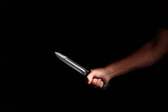 Man's hand with a knife Royalty Free Stock Photo