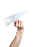 Man's hand launching white paper airplane Royalty Free Stock Photos