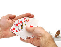 Man's hand lifting up playing cards Royalty Free Stock Photography