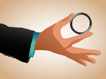 Man's hand with magnifying glass Stock Photos