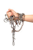 Man's hand and a metal chain Stock Photography