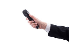 Man's hand with a microphone Royalty Free Stock Images