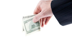 Man's hand with a one hundred dollars Royalty Free Stock Image