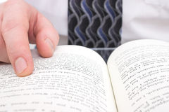 Man's Hand On Open Book stock image