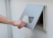Man's hand open the post box Stock Images