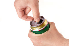 Man's hand opening aluminum beer can Stock Photos