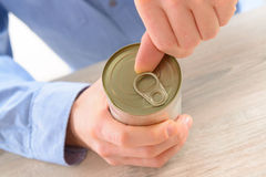 Man's hand opening can Stock Photography