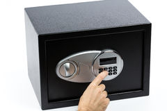 Man's hand opening electronic door of a safe deposit box. On white background Stock Photos