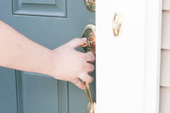 Man's hand opening front door Royalty Free Stock Photo