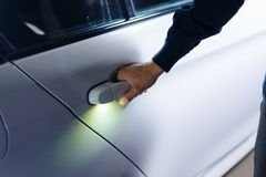Man`s hand opens the car royalty free stock photo