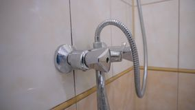 A man`s hand opens the water tap in the bathroom and closes it back. Close-up of the screen and a man`s hand. Bathroom stock video