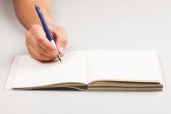 Man's hand with pen, writing something Royalty Free Stock Images