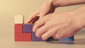 Man`s hand picking 3D tetris stock video