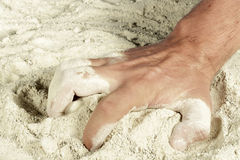 Man's hand picking a handful of sand Royalty Free Stock Images