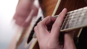 Man's hand playing guitar stock footage