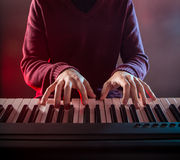 Man's hand playing piano. Close-up Royalty Free Stock Photos