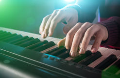 Man's hand playing piano. Close-up Stock Images