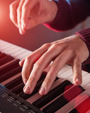 Man's hand playing piano. Close-up Royalty Free Stock Photography