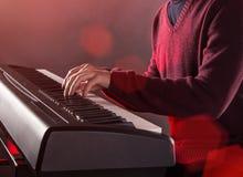 Man's hand playing piano. Royalty Free Stock Photos