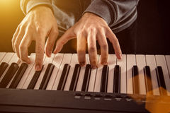 Man's hand playing piano. Stock Images