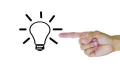 Man`s hand pointing to light bulb on white background Royalty Free Stock Photography